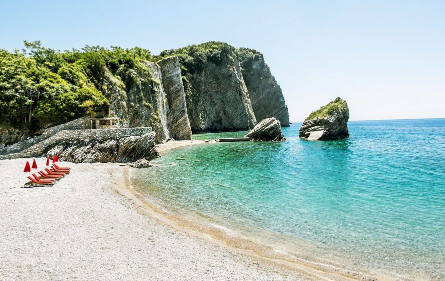 The beach and the cliffs on the island of St. Nicholas in Budva Montenegro.Paradise beach on an island in the sea